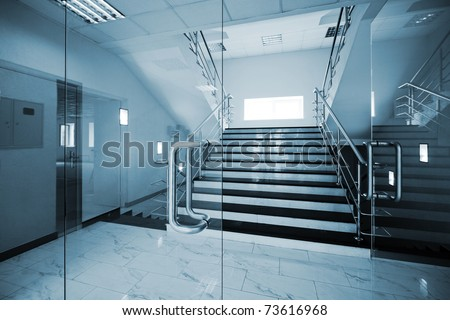 Glass doors with a kind on a marble staircase - stock photo