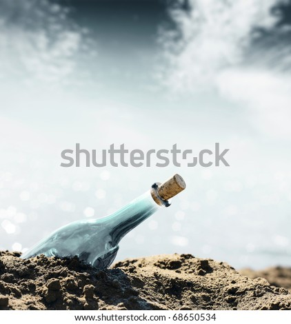 Glass empty bottle in coast sand and sky with clouds - stock photo