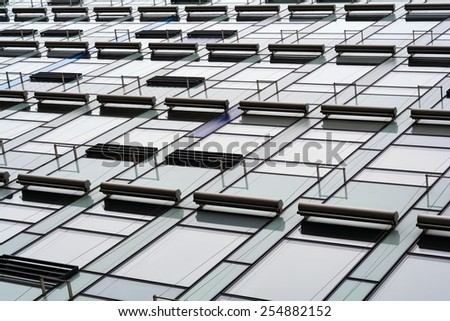 glass facade of a house in Berlin - stock photo