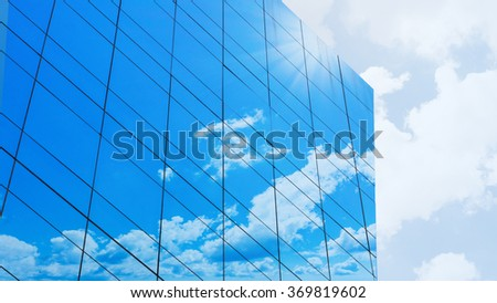glass facade with cloud on the modern building - stock photo