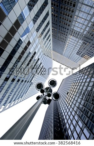 glass facades of modern of tall buildings and skyscrapers