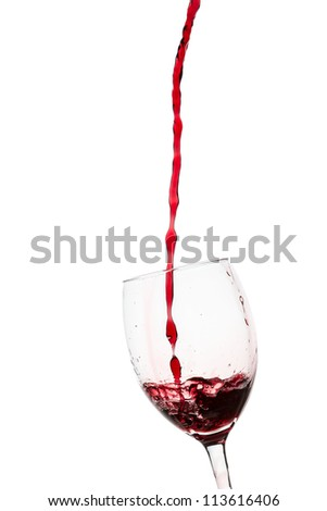 Glass filled with a red wine on white background - stock photo