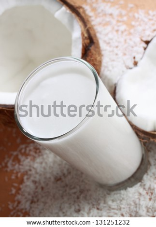 glass filled with coconut milk, shallow dof. - stock photo