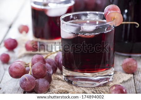 Glass filled with Red Grape Juice - stock photo