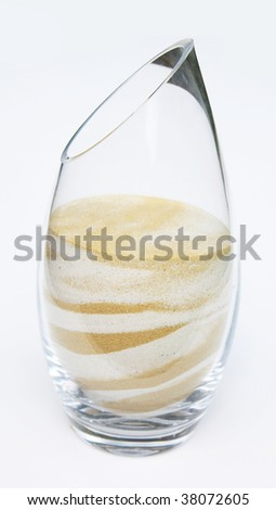 Glass filled with sand - stock photo