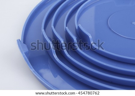 glass food container with blue plastic lid isolated on white background - stock photo
