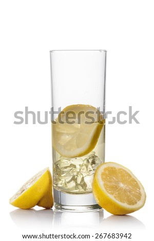 glass full of fresh lemonade and ice cube, on white background - stock photo