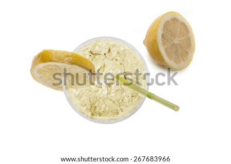 glass full of fresh water with lemon, on white background - stock photo