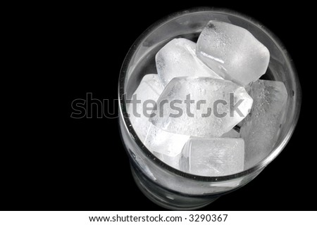 glass full of ice from above - stock photo
