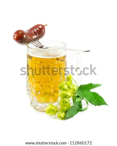 glass glass of light beer and branch of hop - stock photo
