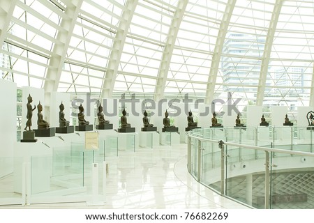 Glass, glass room lined with Buddha images - stock photo