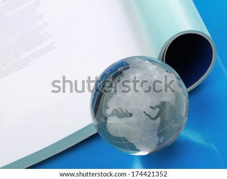 glass globe lying on book