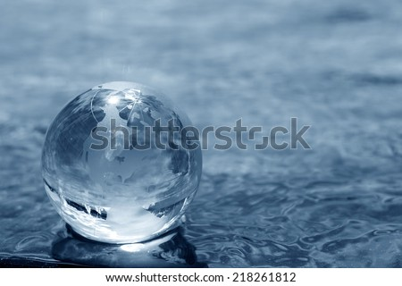 glass globe on water - stock photo