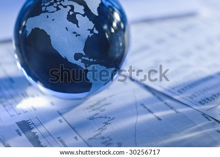 Glass globe with North America and business papers - stock photo