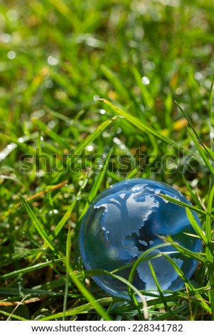 Glass globe with North America in fresh grass concept for environment - stock photo