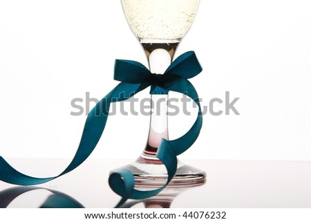Glass goblet with white wine and blue tape - stock photo
