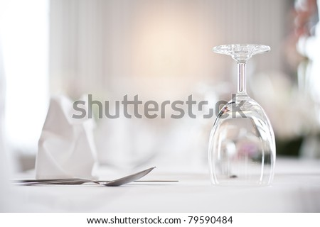 Glass goblets on white table - stock photo