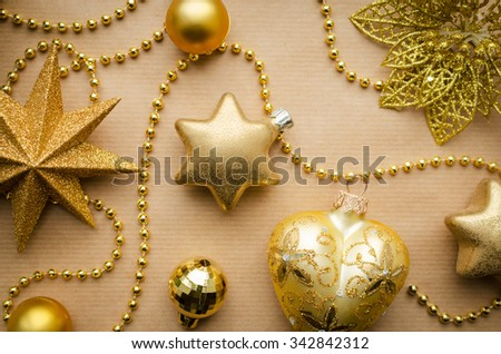 glass golden christmas decorations background on vintage craft paper space for copy text - stock photo