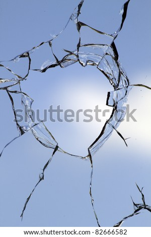 Glass  hole  cracks  broken - stock photo