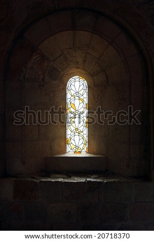 Glass in lead window in a middle aged church - stock photo