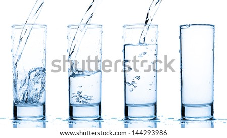 glass is filling up with water - stock photo