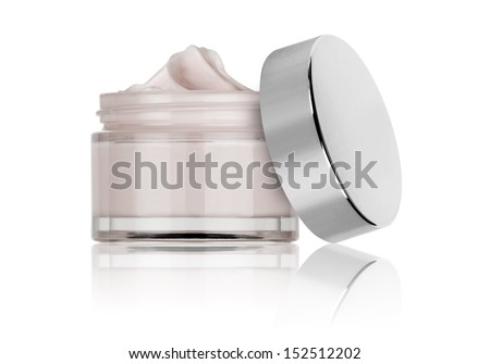 glass jar of beauty cream with cap, isolated  - stock photo