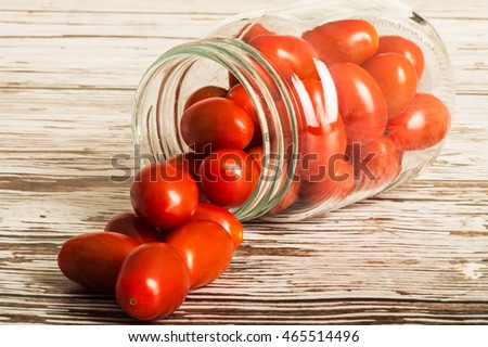 Glass Jar of Fresh Ripe Uncooked Plumb Tomatoes