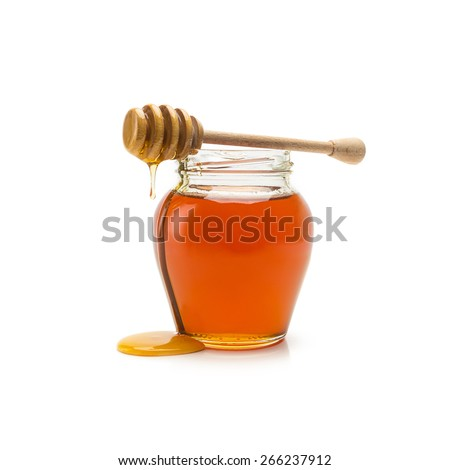 glass jar of honey and stick isolated on white background - stock photo