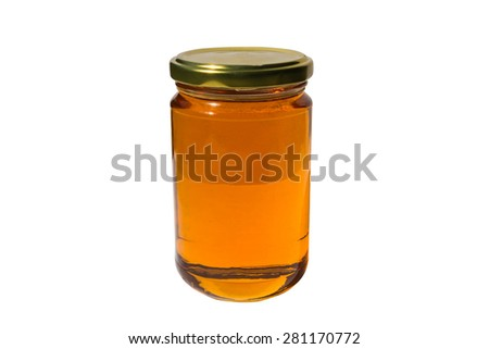 Glass jar of honey with clipping path - stock photo