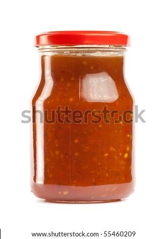 Glass jar of hot tomato sauce - stock photo