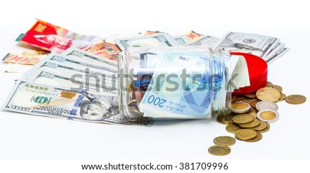 glass jar of pile of New Israeli Shekels banknotes with the new 200 NIS and Pile of dollars
