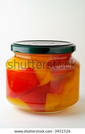 Glass jar of preserved peppers - stock photo