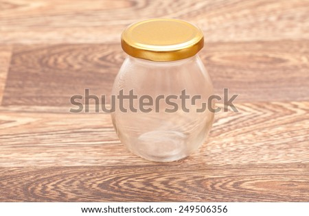 glass jar on wooden table  - stock photo