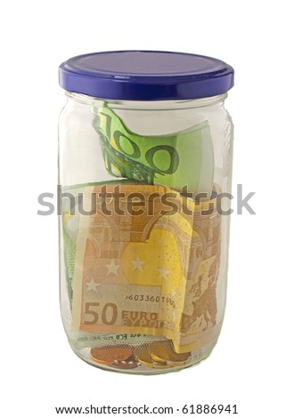 Glass jar with blue cap full of money - stock photo