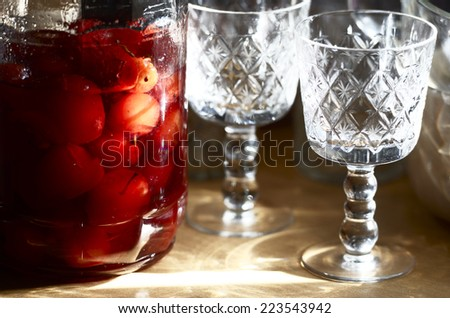 glass jar with canned apples sunlit, horizontal - stock photo