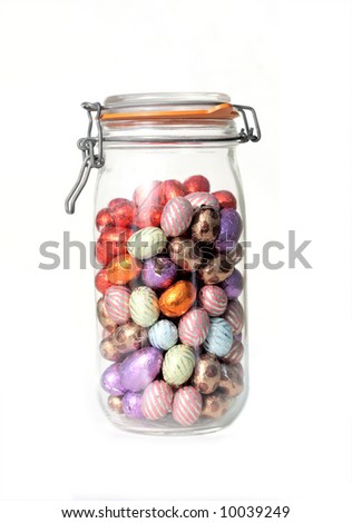 glass jar with chocolate easter-eggs, on white - stock photo