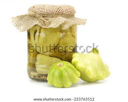Glass jar with pickled squash pattypans on a white background - stock photo