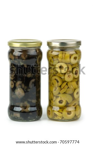 Glass jar with sliced green and black olives  isolated on the white background - stock photo