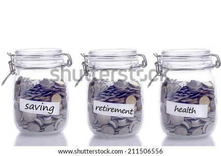Glass jars full with coins: Saving, retirement and health text