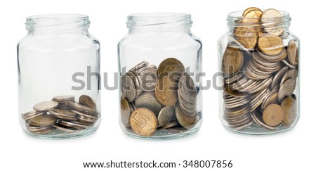Glass jars with coins  - stock photo