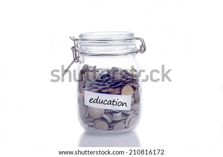 Glass jars with coins and 'education' text - stock photo