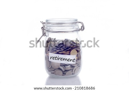 Glass jars with coins and 'retirement' text  - stock photo