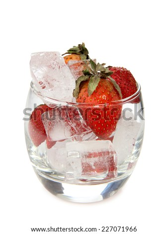 Glass jars with ice and strawberries on a white background - stock photo