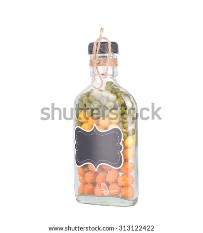 Glass jars with nut on a white background