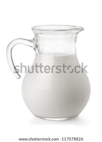 Glass jug of fresh milk isolated on white - stock photo