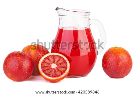 Glass jug with bloody orange juice isolated on white background - stock photo