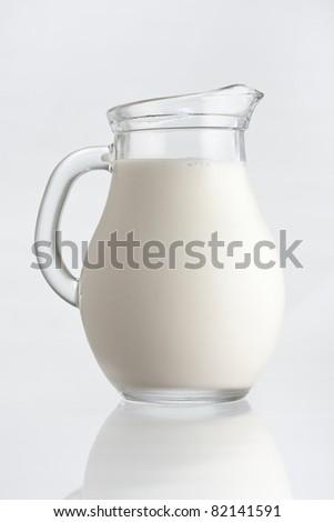 Glass jug with fresh milk - stock photo
