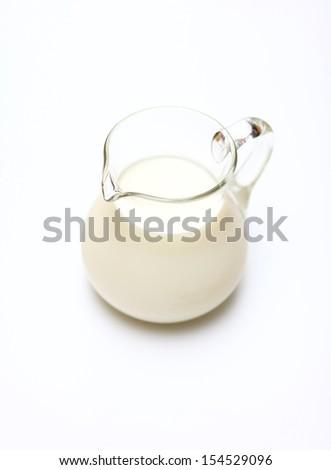 Glass jug with milk - stock photo