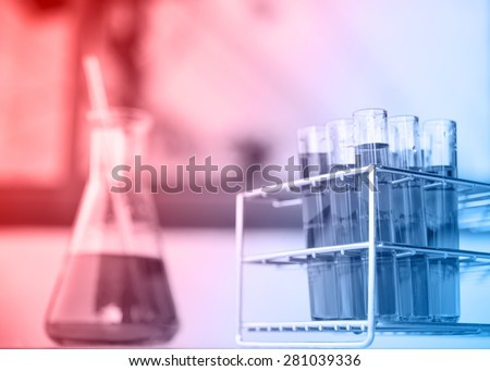 Glass laboratory chemical test tubes with liquid - stock photo