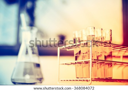 Glass laboratory chemical test tubes with liquid. Selective focus effect - stock photo